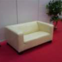 Example photo of a sofa on red carpet
